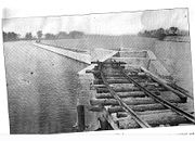 The breakwater pier is cemented and nearly complete (1907).