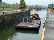 A canal barge entering the lock.