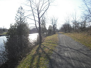 The Canalway Trail adjacent to the current Erie Canal in New London.  This is part of the Old Erie Canal State Historic Park section.