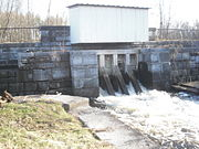 The stone spillway that controls the water depth at the west end of Erie Canal Village.